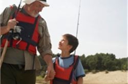Youngster dips fishing rod to beat dad